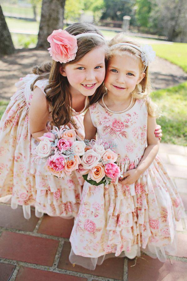 http://www.elizabethannedesigns.com/blog/2013/05/21/pink-gold-austin-wedding/floral-and-ruffled-flower-girl-dresses/