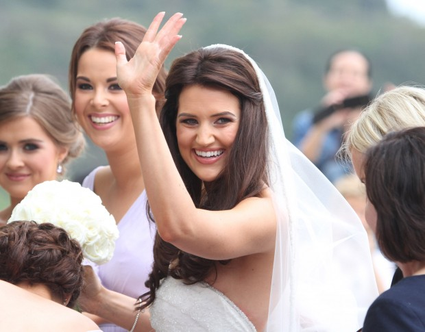 Bride to Be. A radient Rachael Cunningham waves to the crowd awaiting her arrival at St Mary's Church in Killybegs.  (North West Newspix)