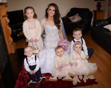 The happy bride, Cathy Kelly alongside her flower girls Sarah-Louise Kelly, Jasmine Mc- Crabbe and Sinead McMenamin and her pageboys, James McCrabbe and Darragh Ferry.