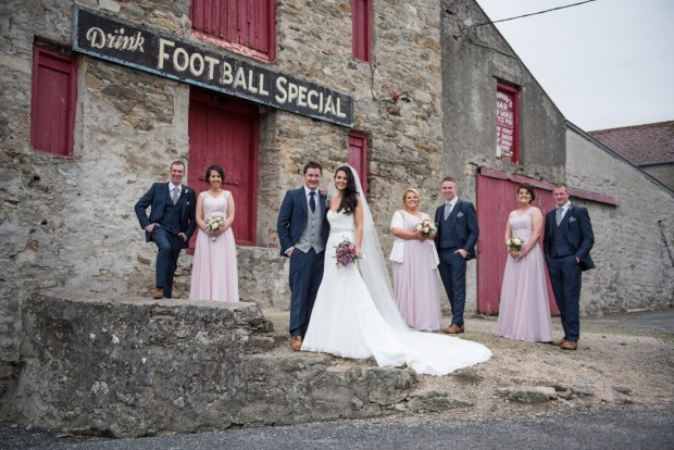 The new Mr and Mrs McBride alongside maid of honour Bridgeen Dugan, bridesmaids Frances Gormley and Marie Gormley. Also pictured is best man Cathal Sheerin and groomsmen Stephen McManus and Gerard McBride.