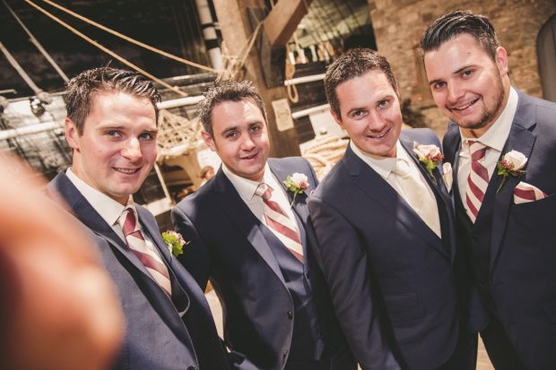 Groom Christopher McKenna is all smiles with groomsmen Ryan, Fergal and Barry McKenna on his wedding day.
