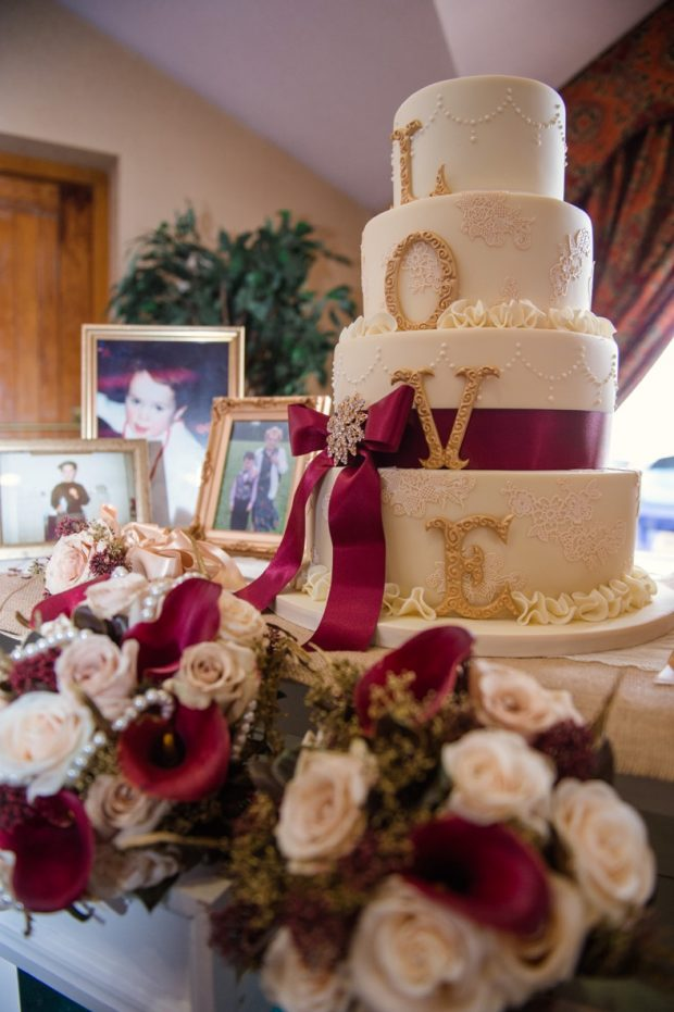 The newlyweds' four tier cake, which was decorated with delicate pearls and a crimson bow to tie with their 'love and country' themed autumnal wedding.