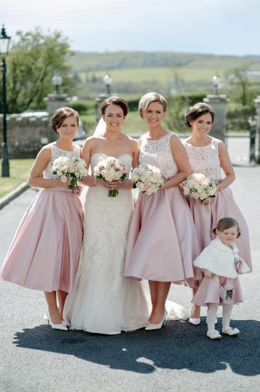 The new Mrs McAnespie, alongside maid of honour, Fiona Glynn, bridesmaids Louise Mallaghan and Seanan Loughran and flower girl, Saorla Mallaghan.