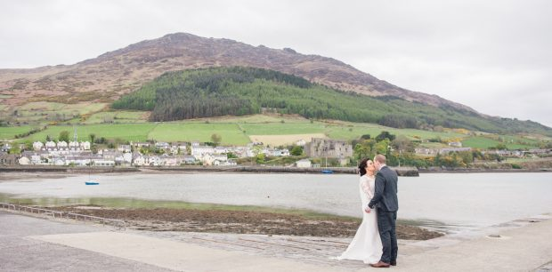 Michaela and Eoghan share a romantic kiss on their wedding day.