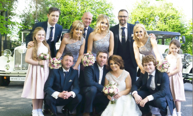 The new Mr and Mrs McSwiggan, alongside maid of honour, Caoimhe Ferry, bridesmaids, Patricia Murphy, Karen Grimes, junior bridesmaid, Aoife Emma-jo Ferry, and flower girl, Cobhlaith Murphy. Also pictured is best man, Myles McCord, groomsmen Mark Douglas, Chad Mostran and Chris McCourt, and Caolan, Denise's son who gave her away.