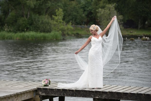 The new Mrs Swift shows off her wedding gown, which featured ivory lace, crystals and a matching veil.