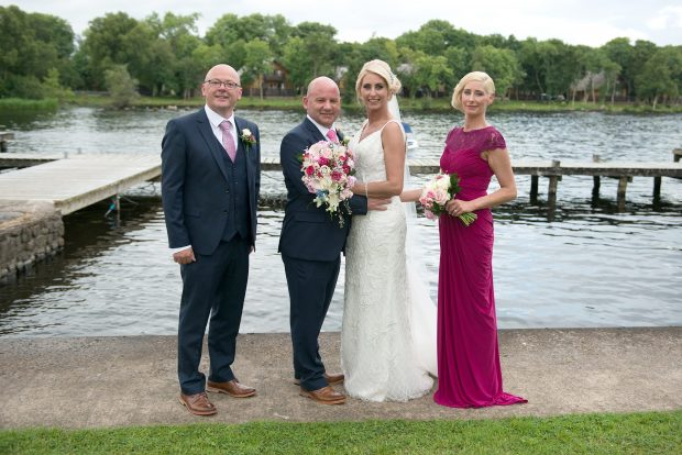 The newlyweds, Liam and Margaret Swift, alongside their maid of honour Catherine Adams and best man, Nigel Graham.