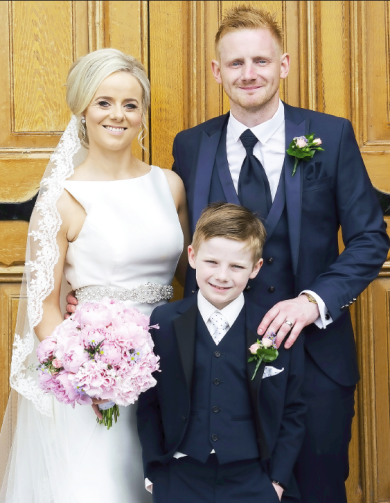 The new Mr and Mrs McConnell, alongside their son Shay.