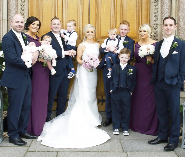 The newlyweds, Siobhan and Gary McConnell, alongside their maid of honour, Michelle Donnelly, best man, Stephen McConnell and junior best man, Shay McConnell. Also pictured are bridesmaid Ashleen Keyes, flower girl Mollie-Kate McConnell, ushers The new Mr and Mrs McConnell, alongside their son Shay. Matthew Quinn and Jason Byrne, and page boys, Darragh Donnelly, and Niall and Finn McConnell.