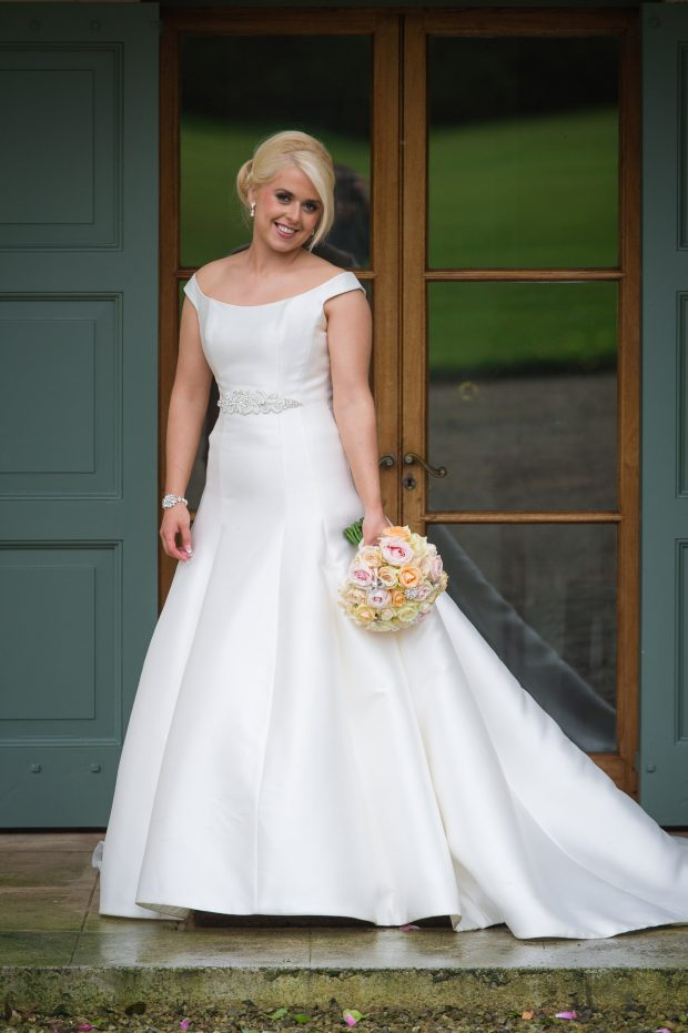 The new Mrs Warrington shows off her elegant Pronovias fitted dress which she purchased from a bridal store in Fivemiletown.