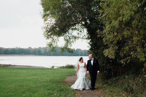 The newlyweds enjoy a stroll in the beautiful Irish countryside on the day of their autumn wedding