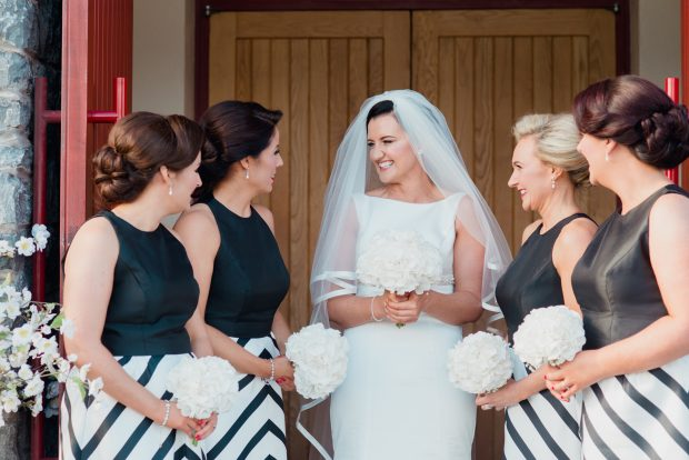 Michelle Lester (née Burns) shares a giggle with her maid of honour, Claire O'Kane, and bridesmaids Maria Ormsby, Sarah McElholm and Claire Burns.