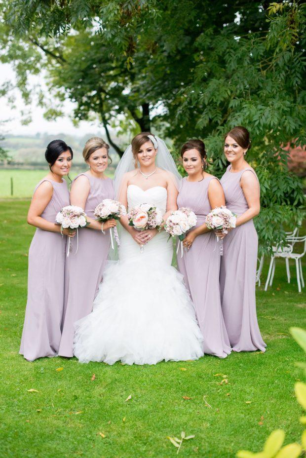 Blushing bride Michelle McCullagh (née McManus), alongside her maid of honour, Leona Mc- Manus, and bridesmaids, Sabrina McKenna, Nicole McManus and Marie McArt.