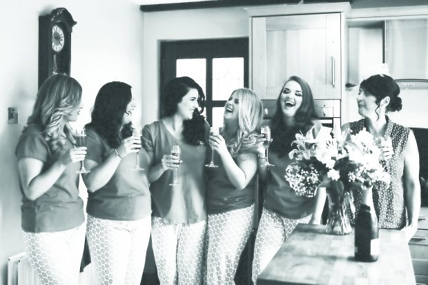The blushing bride, Rachael Eccles shares a laugh with her beloved family and close friends on the morning of her Summer wedding day.