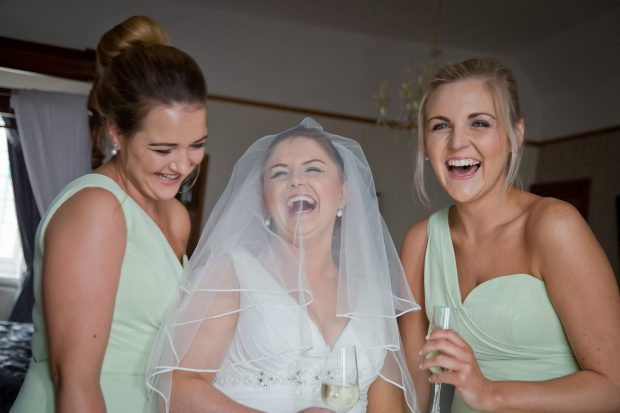 Constance White (née Whyte) couldn't hold back her happiness on her wedding day. She is pictured with her bridesmaids, Louise O'Neill and Lily Magenis.