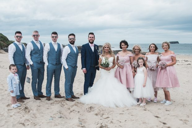 Newlyweds Clare and Declan Patton, alongside bridesmaids Mary Patton, Emily Patton, Naomi Crossan and Anna McGrinder and flowergirl, Paige McLaughlin. Also pictured is best man, Richard Patton, groomsmen Stephen McLaughlin, Tony McLaughlin and Paul Connelly and page boy, Kai McLaughlin.