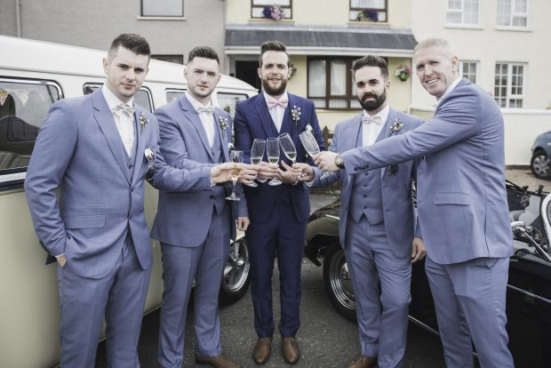 Declan Patton enjoys a glass of bubbly on his wedding day, alongside best man, Richard Patton, and groomsmen, Stephen McLaughlin, Tony McLaughlin and Paul Connelly.