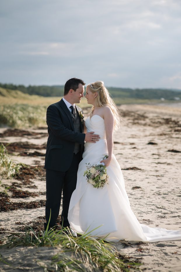 Elaine and Richy enjoy their first romantic stroll as husband and wife. The setting on this very special occasion was Murvagh Beach in Donegal.