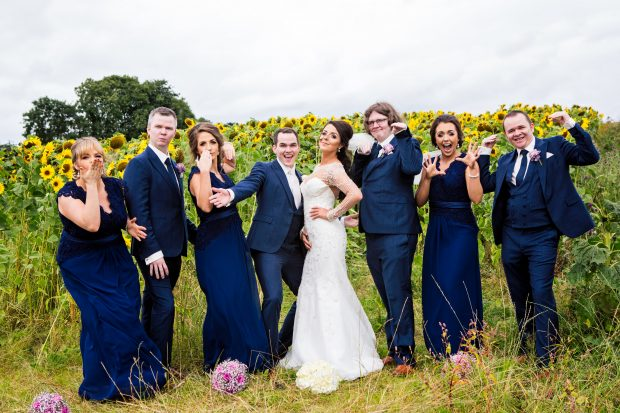 Newlyweds Emma-Louise and Darrel pose for the camera in a field of sunflowers, alongside their maid of honour, Clare Donnelly and best man, Emmet Mulgrew. Also pictured are bridesmaids, Ciara Donnelly and Caroline McNamee and groomsmen, James Mulgrew and Sean Mulgrew.