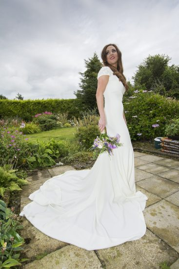 The new Mrs Connolly, holding her bouquet of flowers featuring some cut from her father, Paddy's garden.