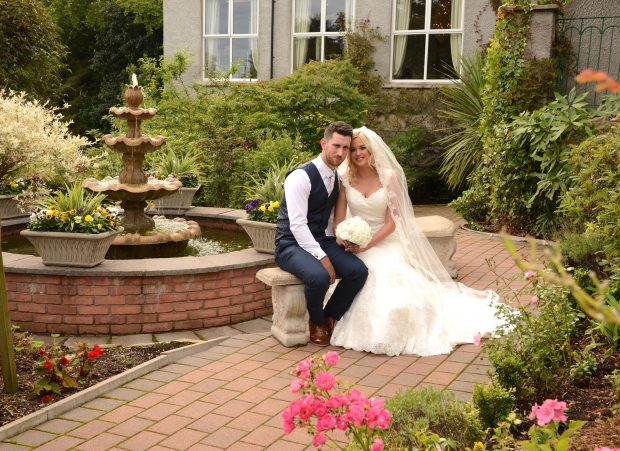 The new Mr and Mrs Reid enjoy a sunshine-filled summer wedding in the breathtaking gardens of Corick House.