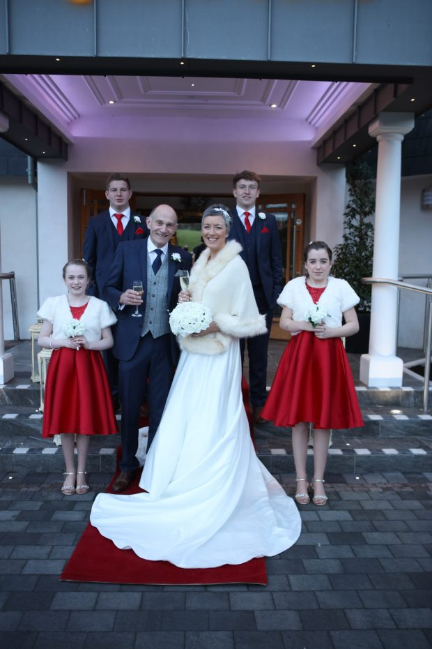 Newlyweds, Alison and Kenny Humphrey enjoying their lovely Winter wedding, alongside their best men, Stephen and Andrew Humphreys and bridesmaids, Grace Melville and Anna Lipczynski.