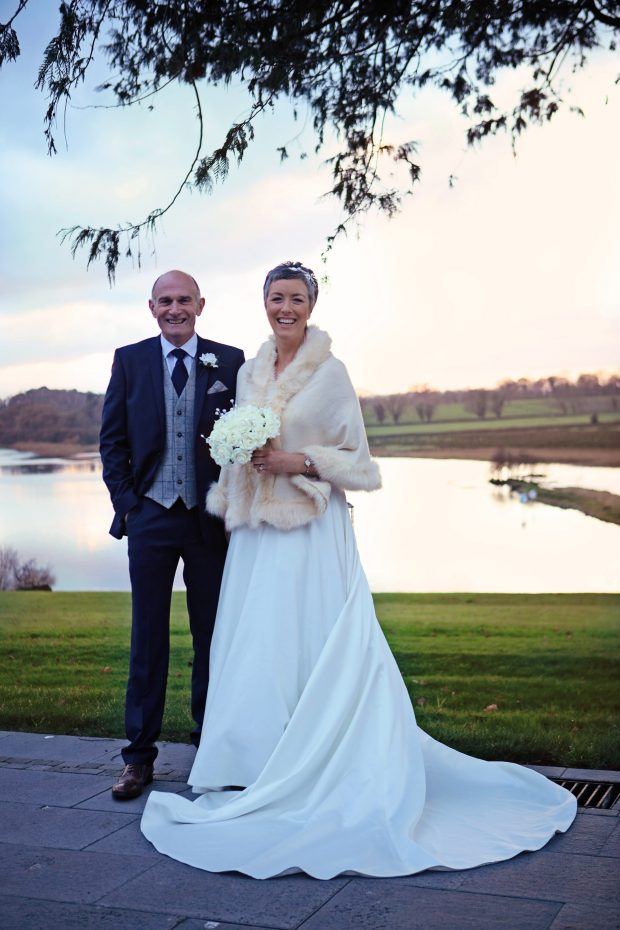 Kenny and Alison Humphreys admire the the beautiful views of the glistening lake at the Killyhevlin Hotel, Enniskillen on their Winter wedding day.