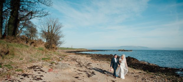 The new Mr and Mrs Devine enjoy a beautiful stroll across a Donegal beach on the afternoon of their Spring wedding.