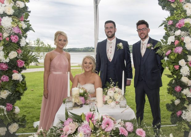 Newlyweds Caoimhe Nic Nia and Christopher Hogshaw, alongside their maid of honour, Naoimh Nic Giolla Eoin, best man Jody Heaney and Callum Hogshaw.