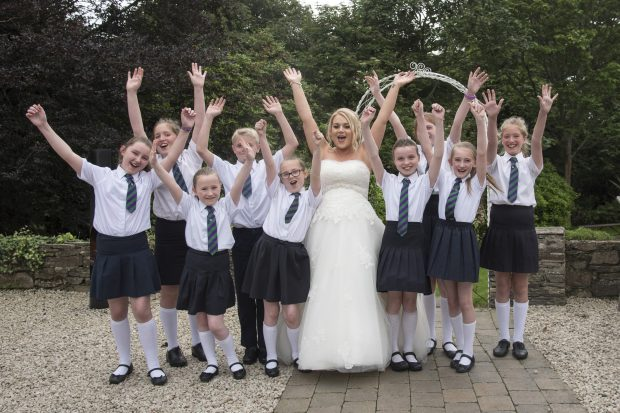 One of the most emotional moments of Caoimhe's big day was when the choir from the school that she works as an Irish Medium classroom assistant, Gaelscoil na gCrann, Omagh, suddenly appeared and sang some of her favourite songs in Irish.