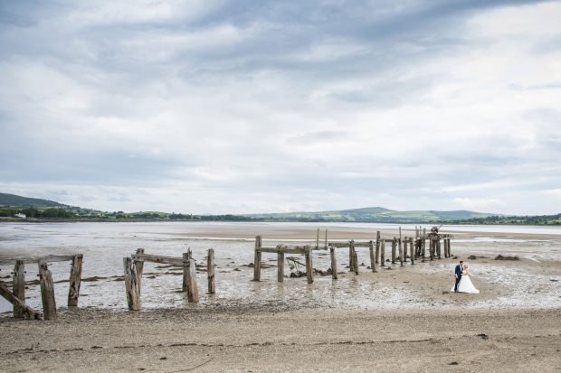 Caoimhe and Christopher enjoy the beauty of a Donegal beach on their wedding day.